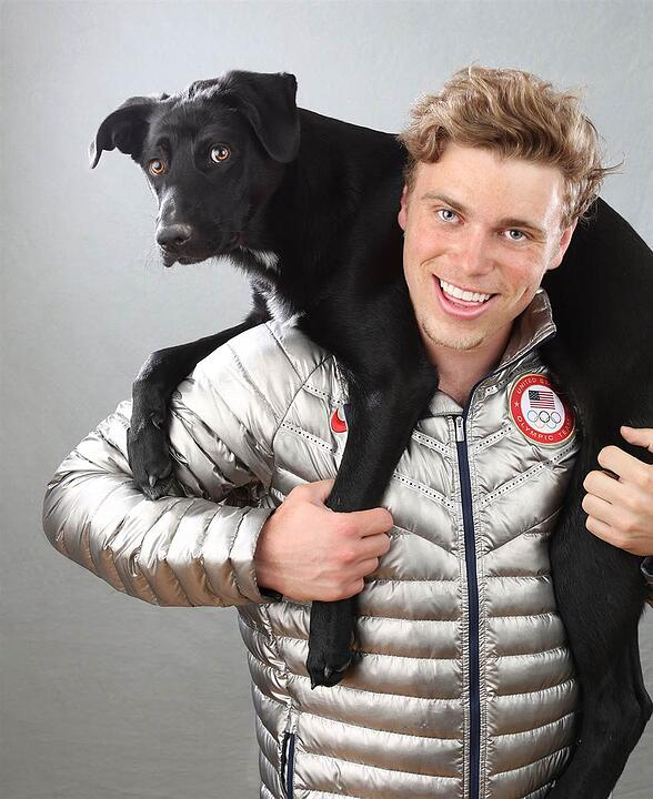 Gus Kenworthy with one of his rescue dogs from Sochi