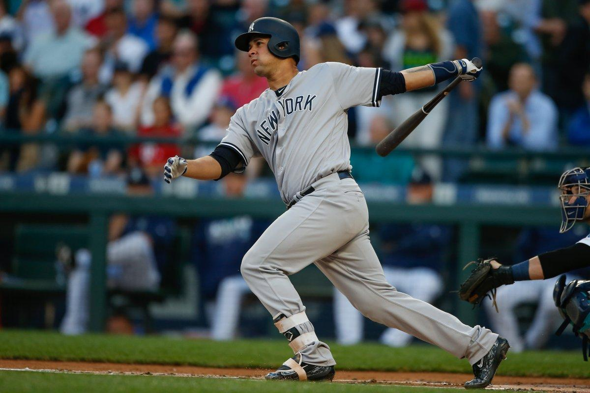 Yankees star catcher Gary Sanchez taking a swing at the plate.