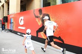 Runner of the future keeping up with his old man at a Gatorade sponsored marathon.