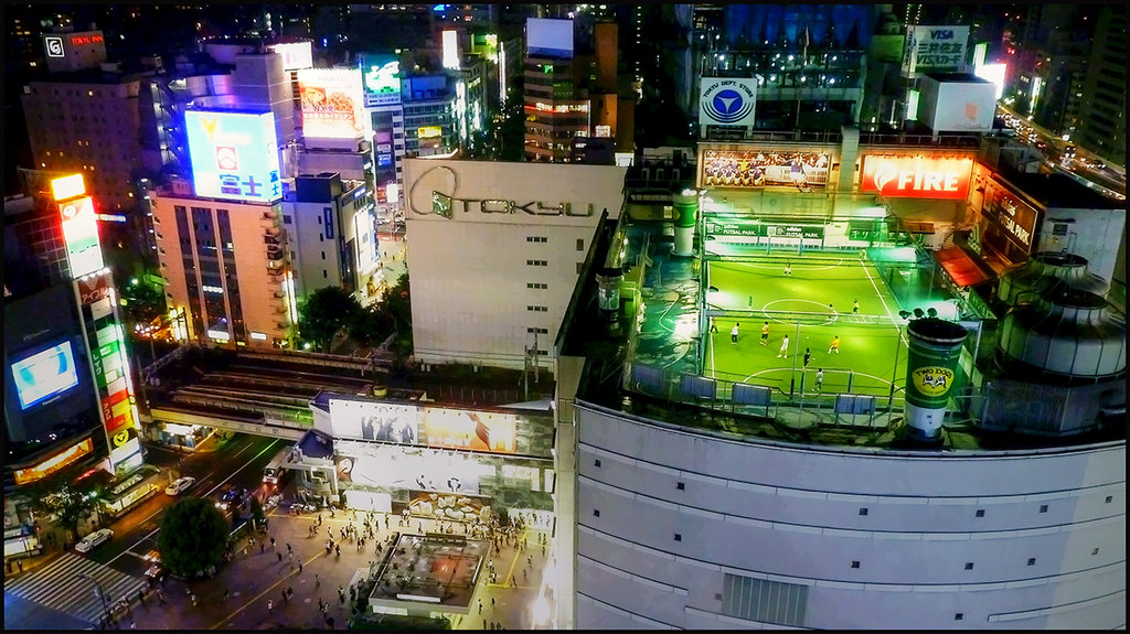 A soccer field on the rooftop of a station in Shibuya, Japan.